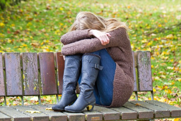 Foto einer jungen Frau mit einer Depression